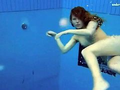 Curly red hair girl swims in her panties