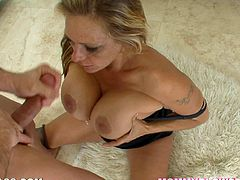 Get a load of this blonde mommy's amazing body and her sucking abilities in this hot video where she ends up with her tits covered by cum.