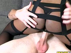 Trashy black woman is going dirty and kinky in Reality Kings porn video. She gets down on her knees taking hard dick in her mouth. She pumps hard dick intensively.