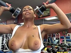 Charming chick Jasmine is having fun with her coach in a gym. She shows her big natural tits to the man and then they have sex in cowgirl and many other positions.