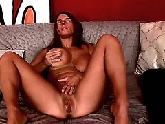 Arousing amateur brunette milf Sexy Susi with big jaw dropping tits and delicious ass takes off black clothes slowly while teasing and starts polishing shaved minge at the interview.