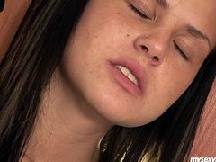 Passionate girlie Jordan wanks in the kitchen using smooth long dildo