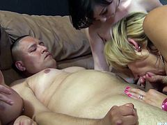 Watch these horny ladies having an amazing time sharing this guy's hard cock in a foursome that you'd love to be a part of.