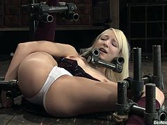 The blonde Ashley Jane gets her pussy toyed while she's involved in a domination session. And she likes it, as she's having multiple orgasms.