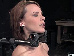 A hot redhead bitch is restrained with bondage machines that render her unable to move and the dude forces his cock in her mouth!