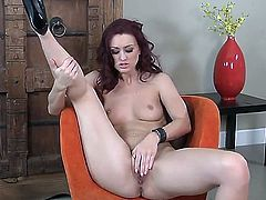 Cool solo masturbation from adorable chick Karlie Montana would make you aroused. The redhead cutie stays in high heeled shoes only before masturbating using fingers  dildo.