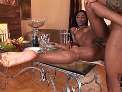 She is hell seductive dark skinned girl. She gives hot foot job working her smooth soles. Then she is penetrated upskirt lying on a glass table. Solid built dude bangs her cunt mercilessly.
