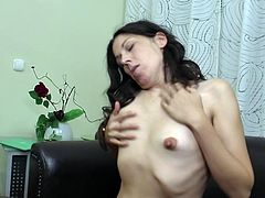 Delana lays on her black leather couch while she is wearing her sexy black lingerie. She rubs her tits and pussy overtop of her lingerie and then sticks her fingers in her mature cunt. She takes off her bra and flicks her nipples fast and hard.