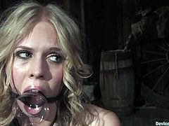 Naughty blonde chick sits on the floor with her legs wide opened. Then she gets gagged and toyed in hot BDSM video.