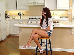 Adorable fit brunette babe Adriana Chechik with natural boobs and smoking hot fit body in hot pants and white shirt teases with long legs during interview filmed in kitchen.