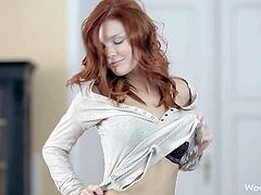 Mia Sollis is a beautiful long haired teen redhead that strips down to her black underwear and bares her perky natural tits in a playful manner. Watch attractive young babe strip.