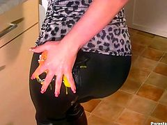 Dark haired curvy housewife wearing tight black leggings messes up the whole kitchen with her stupid actions. She crushes eggs against her ass and pours milk on her top.