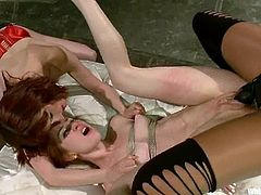 Sweet redhead babe gets bonded and toyed by two chicks