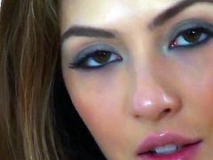 Young pretty brunette Cassie Laine with natural boobies and long legs in stockings only spreads legs and polishes shaved cunny to warm orgasmic feeling in close up in bedroom fantasy.
