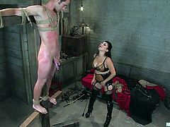 Our Mexican whore Sativa knows what a man really needs is some humiliation and a hell of a spanking. She tied Nomad on this wooden beam and spanked his body so hard that he turned red. Perhaps the brunette has something else for him other than all that pain. Maybe she wants to pleasure his dick and get some spunk.