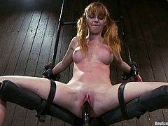 The pigtailed redhead babe Marie McCray is going to get her pink pussy toyed while she has her legs spread open by a bondage device.