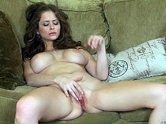 Sweet beauty loves fingering her warm pussy and feel it going wet in solo