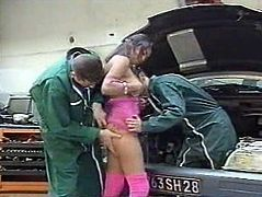 Naughty slut gets her pussy and mouth hole drilled hard by two horny dudes. They repaired her car and satisfied her cum hunger for free.