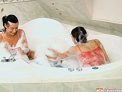 Kinky teen lesbians with appetizing tits and wet coochies are playing with bubbles bathing in the bath tub. Later they eat wet hairy pussy of one another in a hot teen lesbian xxx free porn clip.