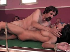 A kinky bondage scene where a fucking dirty-ass fucking whore gets tied up to a pool table and they fuck her. Check it out!