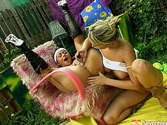 Two insatiable Russian whores make out outdoors during hot summer day. Spoiled brunette lies on her back with legs pulled up while another hoe pokes her snatch with dildo.