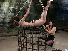 Juliette March moans loudly while being tormented by Bobbi Starr in a vault