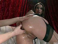 Hot Amber Rayne gets fucked from behind with strap on by another girl. Later on she gets ass fucked by a guy.
