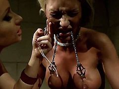 Redhead cougar Katy Parker with pony tail and hot body enjoys torturing tied up blonde Pearl Diamond with perfect hooters in stockings only in her basement in close up.