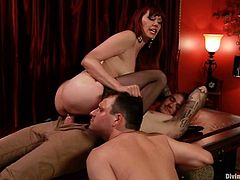 The submissive guy in this video will have to see how the other fella fucks Maitresse Madeline from way too close, and also get fucked by her strapon.