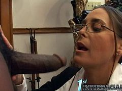 Watch this slutty brunette getting cum all over her glasses in her first interracial scene with a big black monster cock.