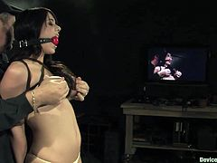 A gorgeous brunette fucking whore with big-ass fucking tits is forced to cum in this kinky bondage scene, hit play and check it out!