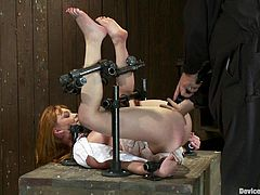 Marie McCray is the redhead beauty placed in an exposed position for easy toying for her pink pussy in this bondage session.
