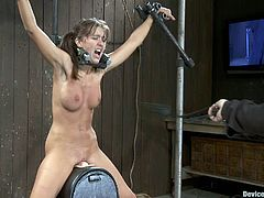This pigtailed chick has her legs and arms spread open in this bondage video where she's tortured with clothespins while she's forced to ride a sybian.