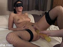Get a load of this hot video where a blindfolded babe has a great time being masturbated by a guy using various toys.