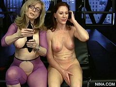 Two babes are spanking each other asses