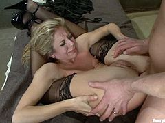 Blonde in stockings and high heels gets her ass toyed and fisted by sexy brunette. Then the blonde gets ass fucked by a guy.