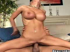 Stunning blonde MILF with big boobs gives hot blowjob and a titjob. Later on she strips her clothes off and gets fucked revere cowgirl by business partner.