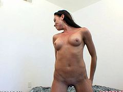 Watch this hot POV where a sexy brunette masturbates with a dildo before sucking and fucking a big cock .