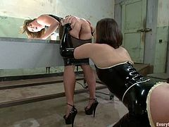 Ariel X and Bobbi Starr take their latex dresses off and toy each others asses with big dildos. After that they also use the strap-on.