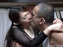 Sweet Japanese girl takes her school uniform off and takes fishnet bodysuit on. Then she sucks a cock and gets fucked hard.