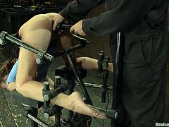 A fucking kinky bitch gets totally toyed with in this super kinky bondage scene with perverted devices, check it out motherfucker!
