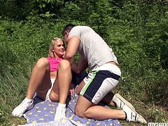Nasty blond chica Caroline with insatiable sex hunger is going kinky and wild with a stranger guy in dirty outdoor XXX porn clip. She flashes perky tits in front of of him so he has a hard boner. He rubs her wet panties kissing passionately in a French way. Blonde sexy girlie moans while getting tight pussy hole finger fucked actively outdoor.