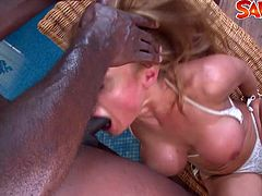 This blonde milf has massive tits. She can fist her own ass hole and take a huge black cock inside.
