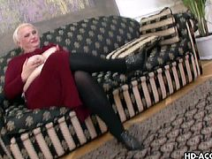 This blonde mature woman is a real fatty. She sits on the couch and it almost breaks under her massive weight. She shows off her tits and then gets to work on sucking cock. She has the men lined up waiting to take a turn at face fucking her.