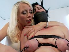 Lorelei Lee ties Belle Noire up and clamps her nipples with electrodes. This sends shocks through her body and the slave loves the pain. She gets an electric prod shoves in her cunt by her mistress and the shockwaves go through her vagina.
