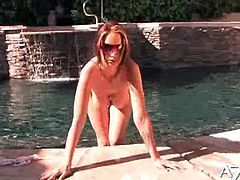 Nikki Nova is stripping in her sexy swimsuit. She takes her bikinis and top off to show her tight pussy and rubs it for you at the pool!