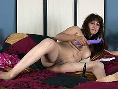 A mature fucking whore gets naked for the camera and fucking sticks a hard toy in that pink wet gash of hers, check it out!