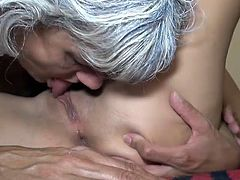 Granny is licking this moist young vagina
