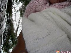 Cuddly babe with beautiful face is playing with snow outdoor. She gets horny so she starts to rubs her hot titties and pussy with snow.