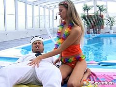Mesmerizing blond babe is having a steamy picnic with a sex hungry sailor by the pool. She gets her small perky tits oral stroked before she climbs on him in pose 69 to give a head in peppering sex video by Seventeen Video.